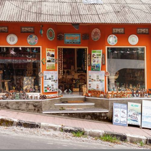 UBUD, INDONESIA - January 24, 2013. Shop and travel agency for tourists. Many souvenirs and tour advertising.