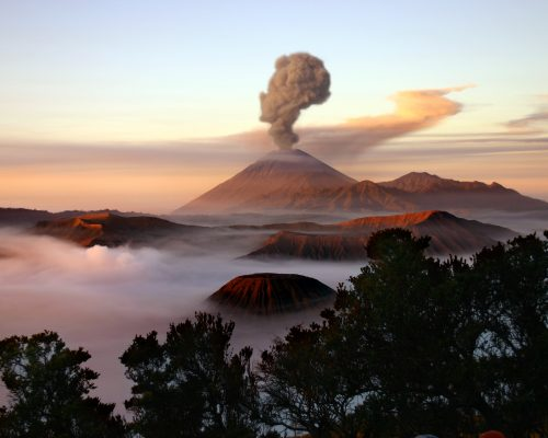 Mount Merapi in Java, Indonesia, with a plume of smoke.